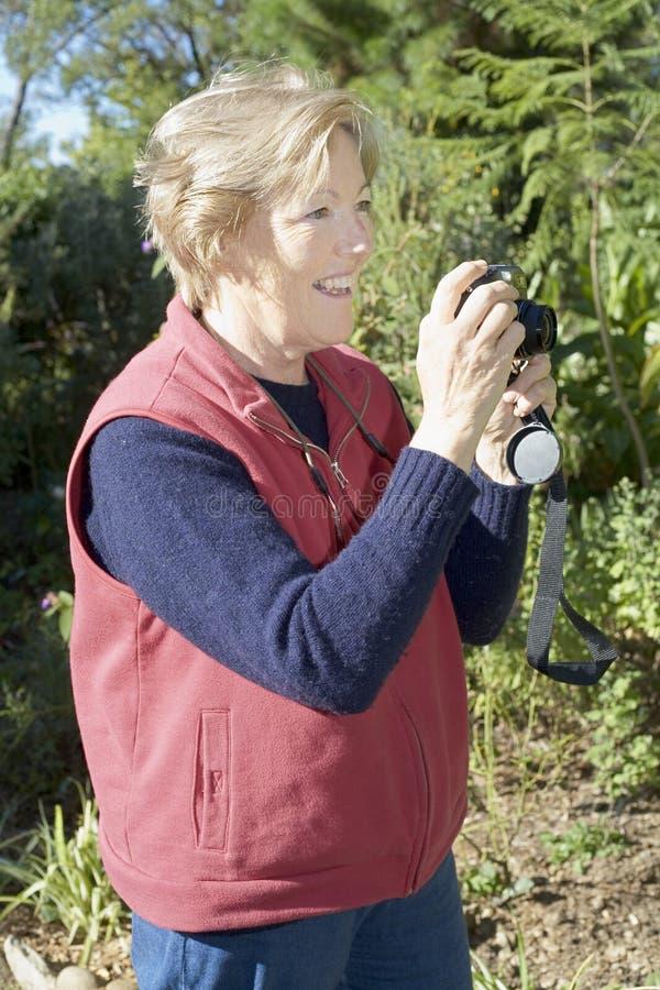 Lady Taking Photographs Stock Photo