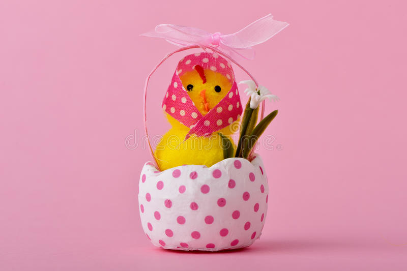 Lady teddy chick emerging from a cracked eggshell stock images