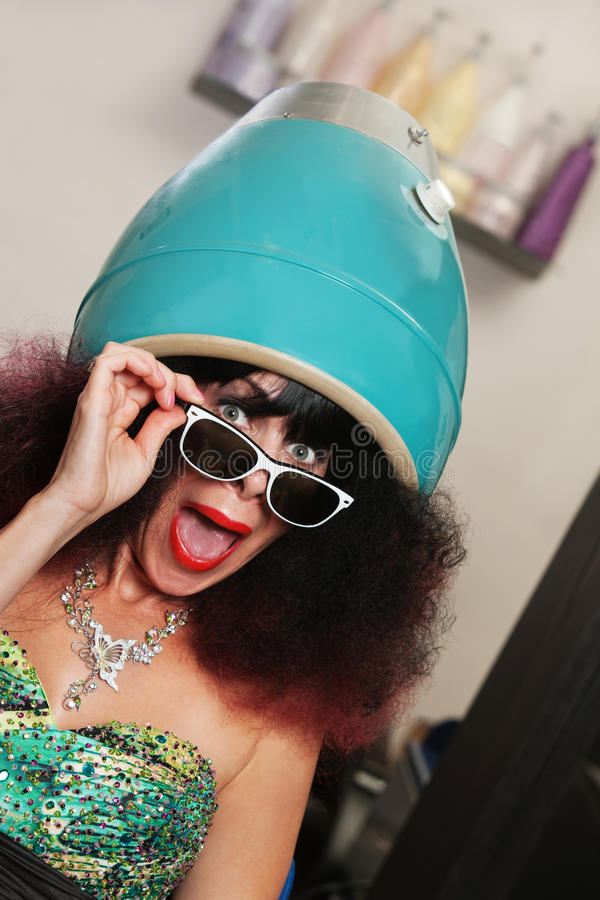 Lady Under Hair Dryer Shouting Stock Photo