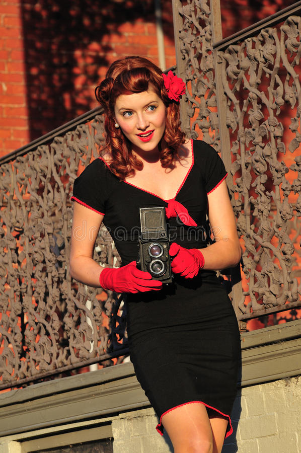Lady using vintage camera stock photos