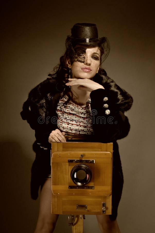 Lady with vintage camera royalty free stock photos