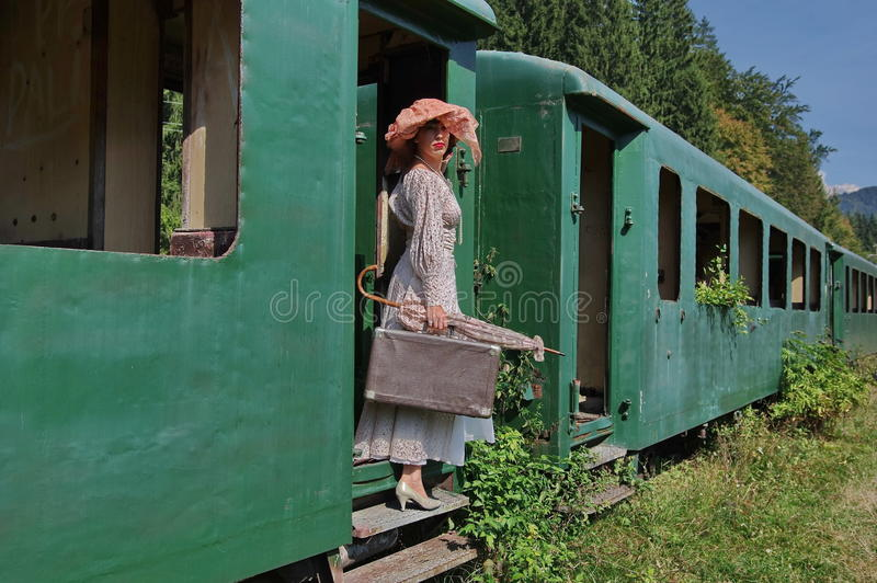 Lady on a vintage train royalty free stock photo