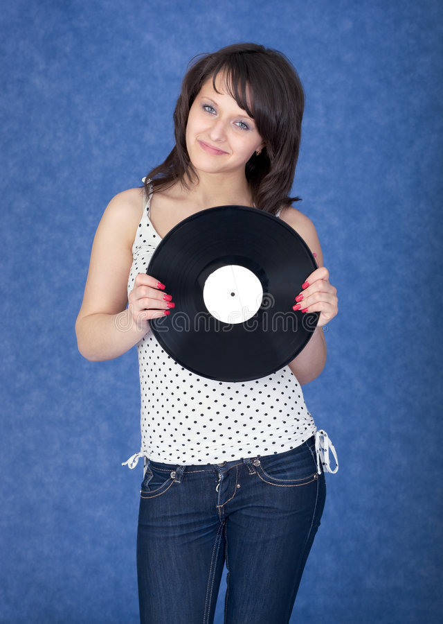Lady with vinyl record. On the blue background royalty free stock image