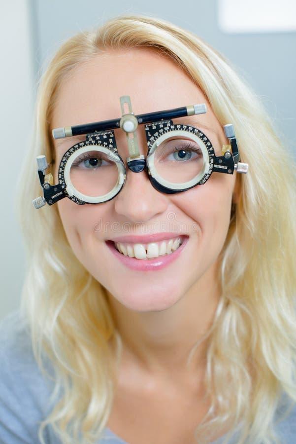 Lady wearing opticians testing glasses stock photo