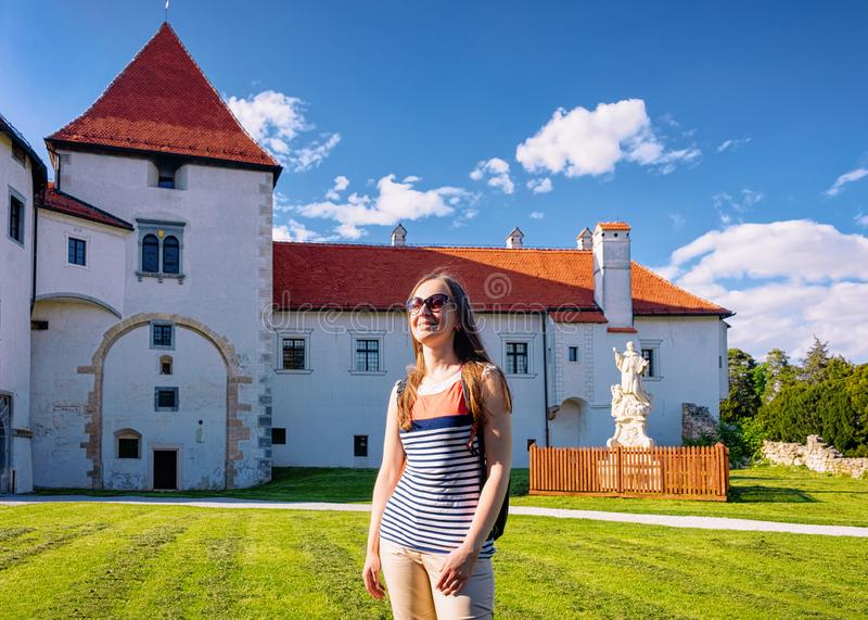 Lady wearing sunglasses at Castle in Varazdin in Croatia. Lady wearing sunglasses at Castle at Street at Old city in Varazdin in Croatia. Panorama and Cityscape royalty free stock photography