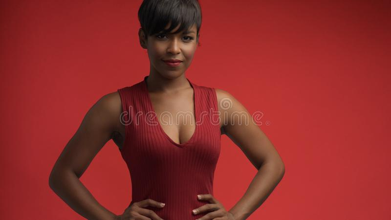 Lady woman in red on red. Mixed race african american woman in red dress on red background royalty free stock photos
