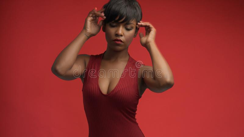 Lady woman in red on red stock image