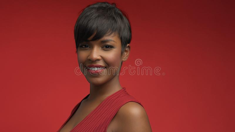 Lady woman in red on red. Mixed race african american woman in red dress on red background stock images