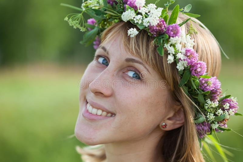 Lady with wreath. Portrait of the young lady with a flower wreath on a head royalty free stock photos