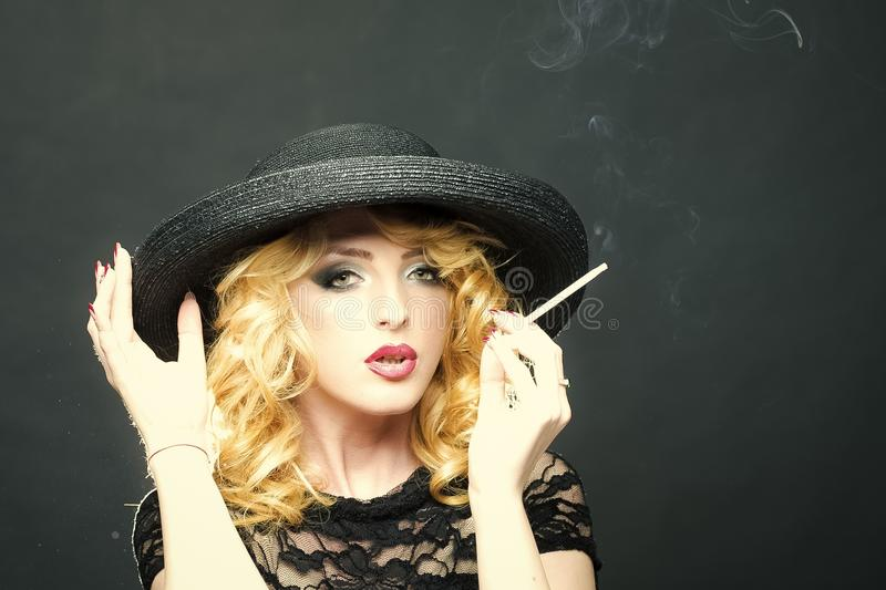 Lady in years smokes a cigarette. Smoking retro woman royalty free stock photo