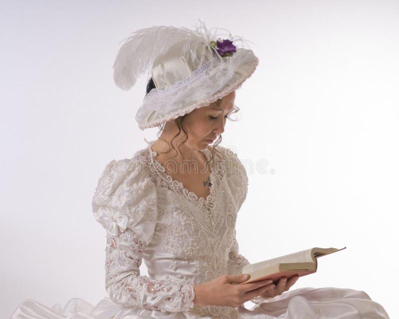 ladyavläsningsbarn royaltyfri bild