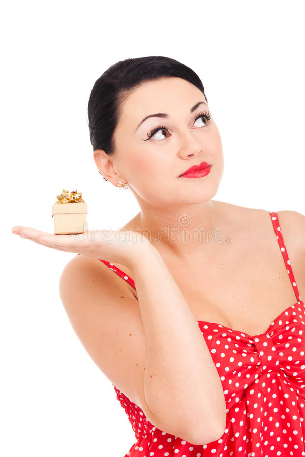 Ladybug and boxed present. Young woman in ladybug-like dress and small boxed present royalty free stock images