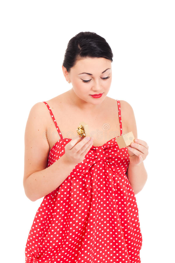 Ladybug and boxed present. Young woman in ladybug-like dress and small boxed present stock photography