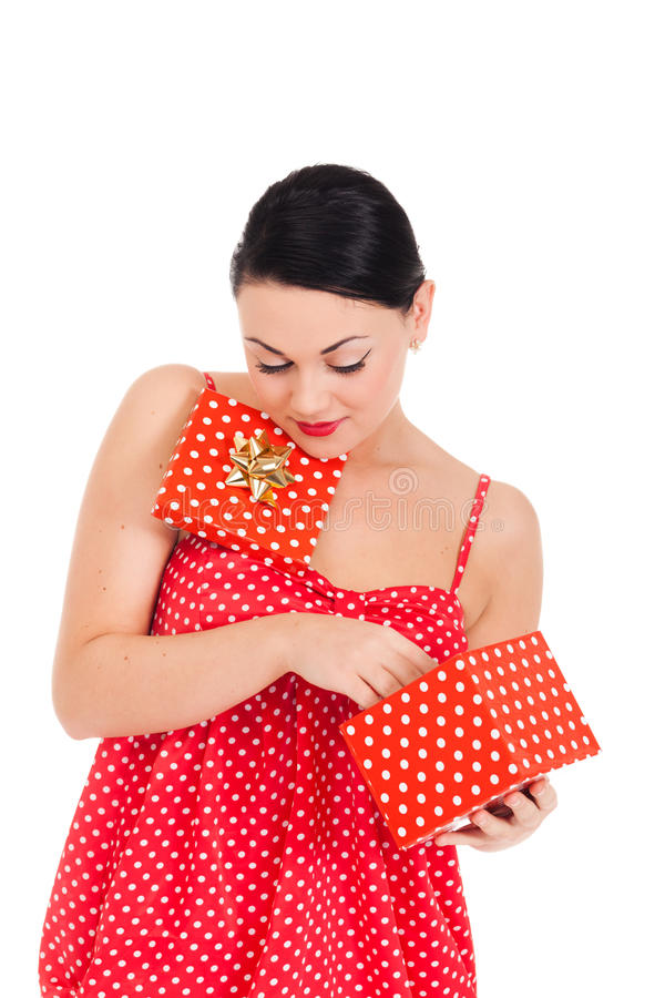 Ladybug and boxed present. Young woman in ladybug-like dress and boxed present royalty free stock images