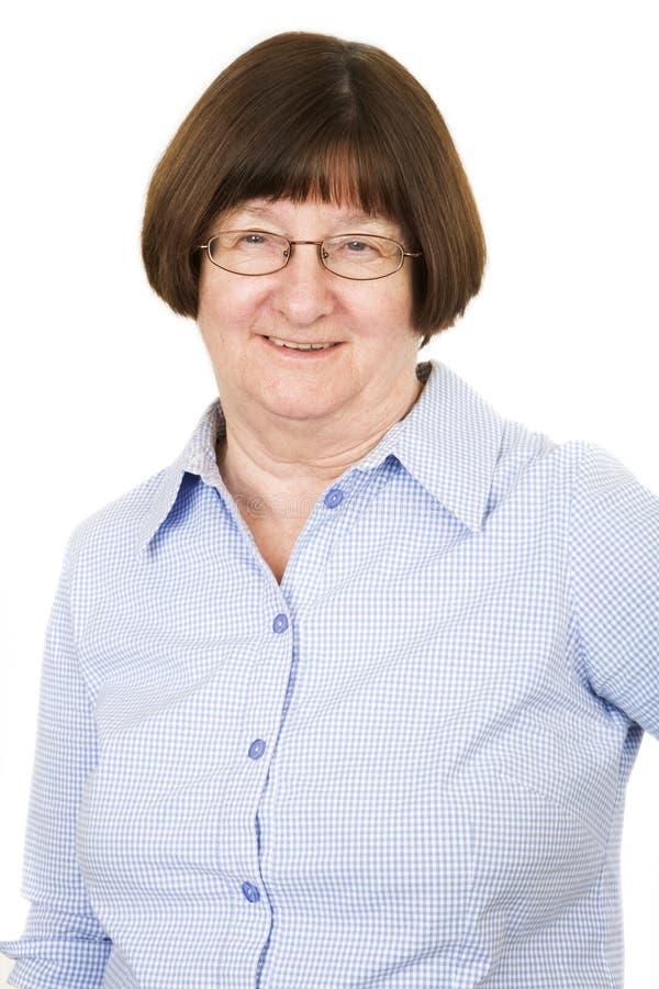 ladyståendepensionär royaltyfri foto