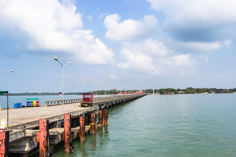 Laem Sok pier is deep sea port a long concrete jetty extended into the sea for ferry services to Koh Kood and chang island. Laem Sok pier is deep sea port a royalty free stock images