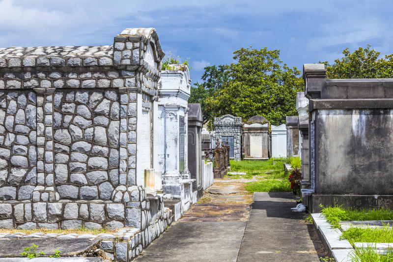 Lafayette cemetery in New Orleans with historic Grave Stones. Historic gravestones at the Lafayette Cemetery No. 1 in New Orleans, USA. It was established in stock photo