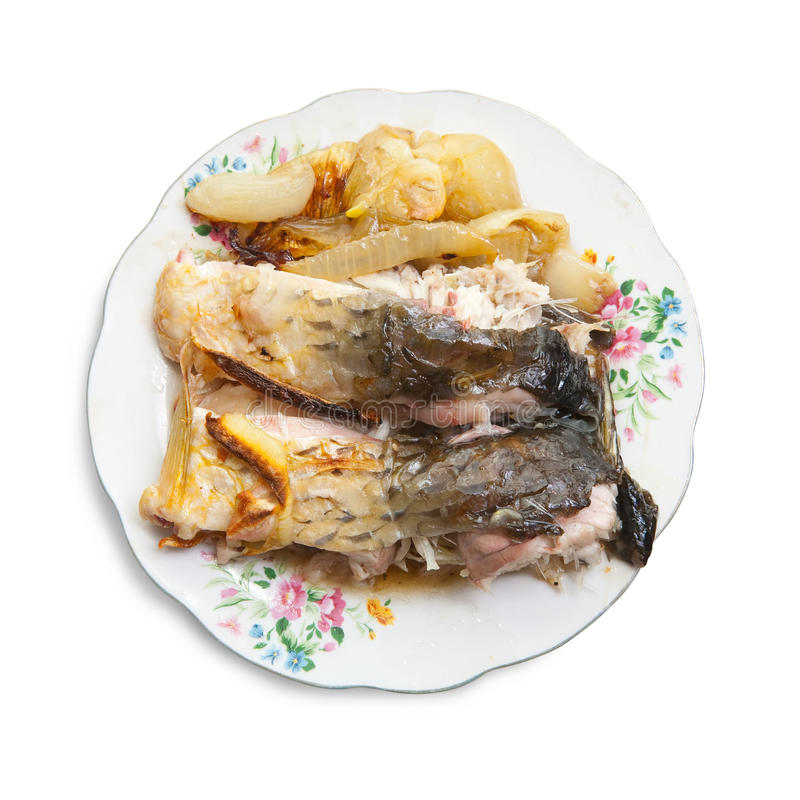 lagad mat fisk över plattawhite arkivbild
