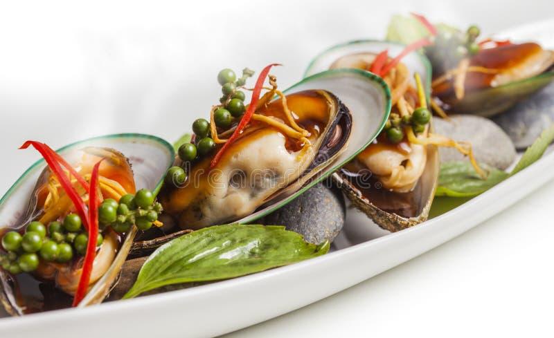 Lagade mat musslor arkivbild