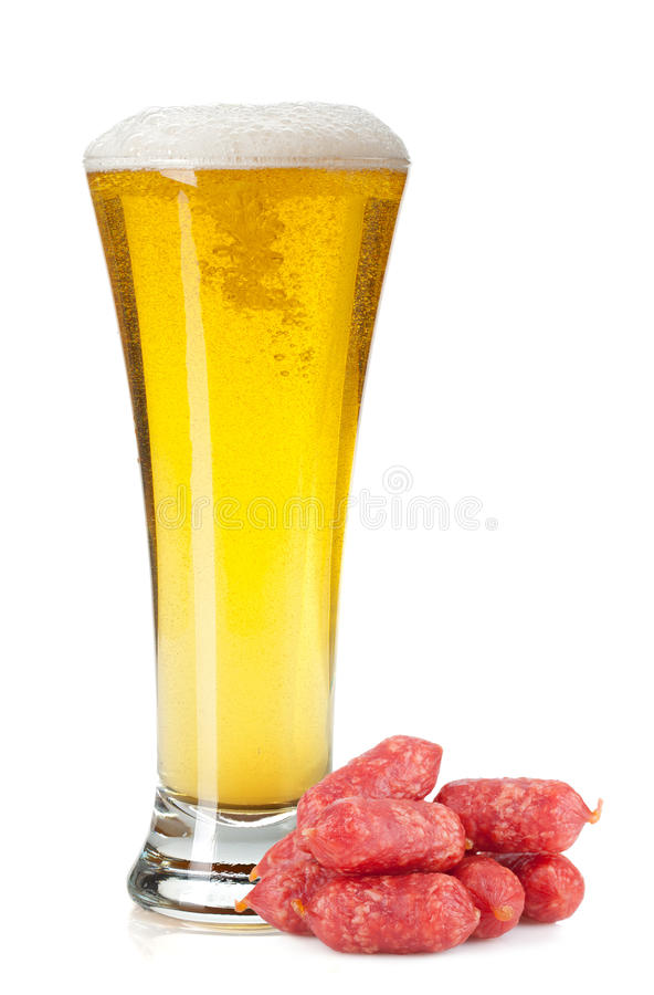 Lager beer glass and mini sausages stock photos