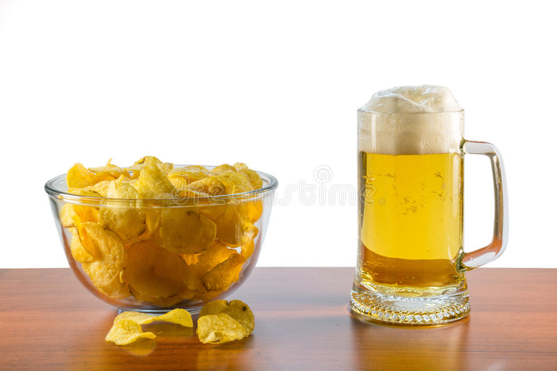 Lager beer and potato chips royalty free stock photo