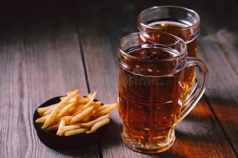 Lager beer and snacks. oktoberfest, bar, pub food. Lager beer and snacks. bar table. restaurant, pub, food concept. delicious drink and french fries. friday royalty free stock photography