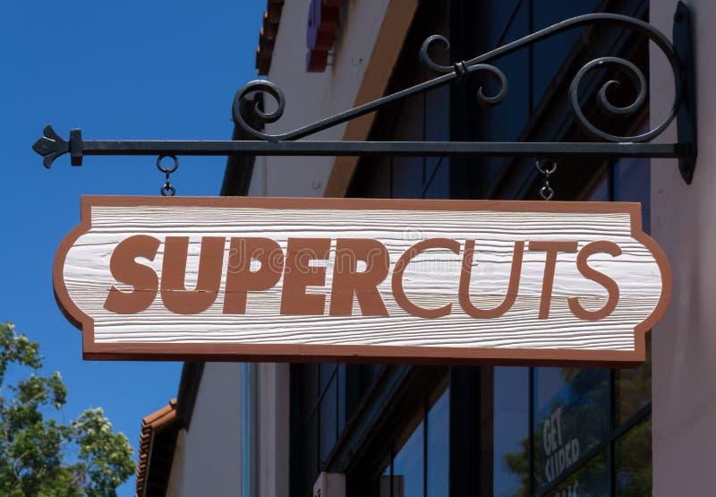 Lager och tecken för Supercuts hårsalong arkivfoton