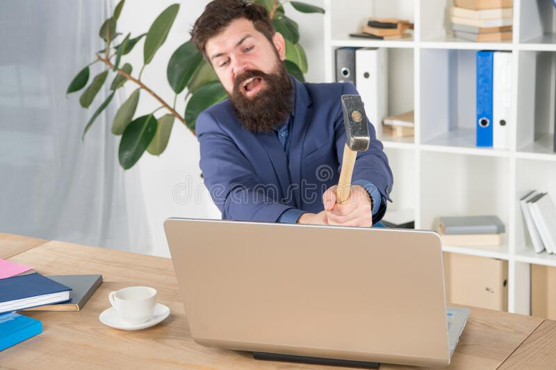 Lagging system. Hate office routine. Man bearded crush computer. Software license agreement. Destroy laptop. Hateful job. Bad computer. Slow internet royalty free stock photo