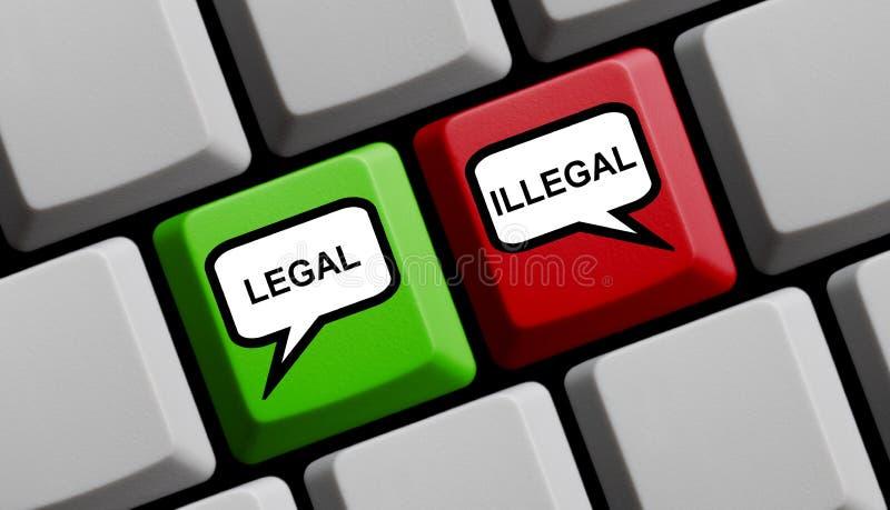Lagligt eller olagligt - datortangentbord royaltyfri foto