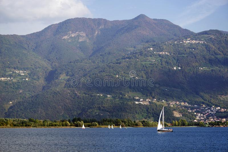 ISEO LAKE, ITALY, 20 OCTOBER, 2018: Yachting on Iseo Lake, near to Lovere town. Lago d`Iseo or Sebino is the fourth largest lake in Lombardy, Italy, fed by the stock photos
