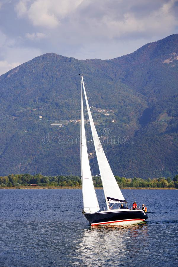 ISEO LAKE, ITALY, 20 OCTOBER, 2018: Yachting on Iseo Lake, near to Lovere town. Lago d`Iseo or Sebino is the fourth largest lake in Lombardy, Italy, fed by the stock photo