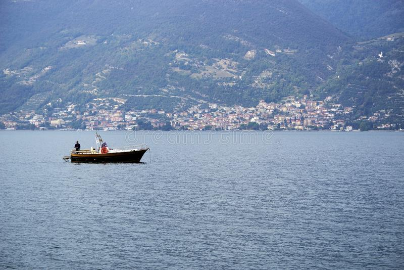 ISEO LAKE, ITALY, 20 OCTOBER, 2018: Boat on Iseo Lake. Lago d`Iseo or Sebino is the fourth largest lake in Lombardy, Italy, fed by the Oglio river. It is in the stock photo