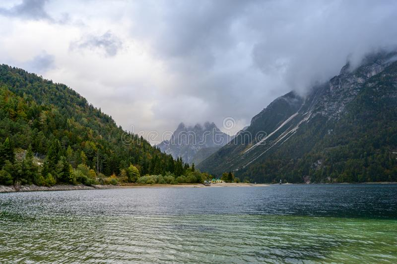 Lago del Predil  in fall. Lago del Predil  is a lake near Cave del Predil, part of the Tarvisio municipality in the Province of Udine, in the Italian region of royalty free stock image