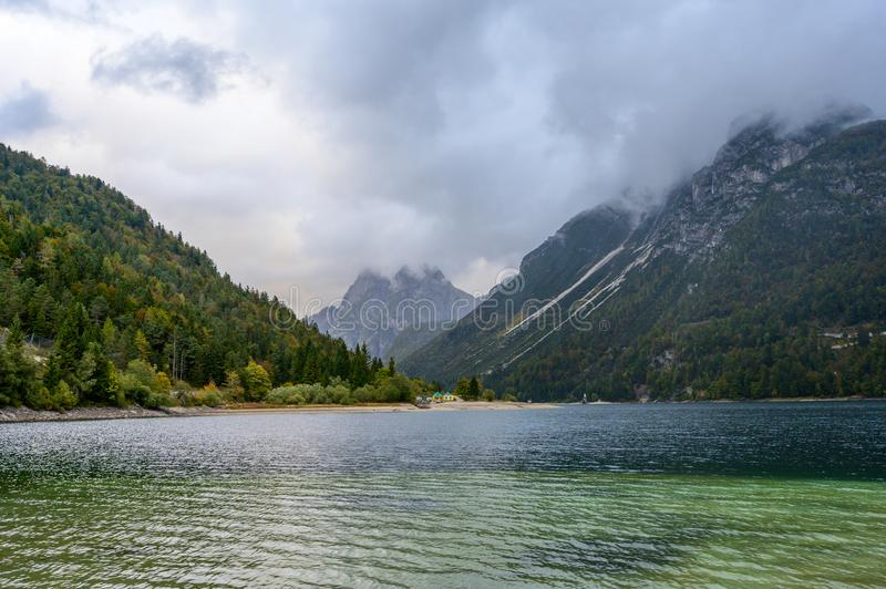 Lago del Predil  in fall. Lago del Predil  is a lake near Cave del Predil, part of the Tarvisio municipality in the Province of Udine, in the Italian region of royalty free stock photography