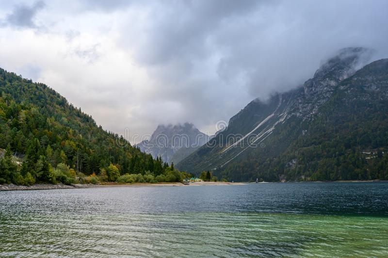 Lago del Predil  in fall. Lago del Predil  is a lake near Cave del Predil, part of the Tarvisio municipality in the Province of Udine, in the Italian region of royalty free stock images