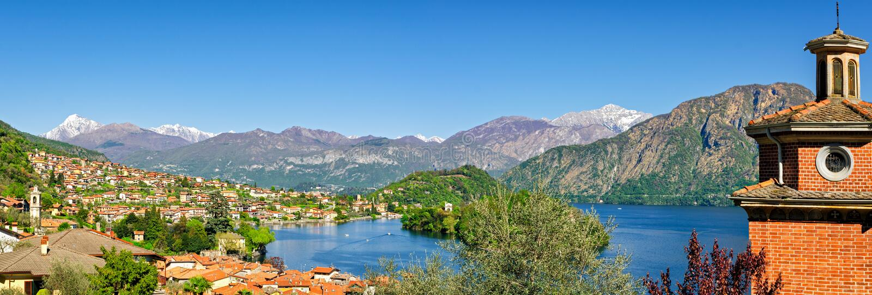 Lago di Como hög definitionpanorama med Ossuccio royaltyfri bild