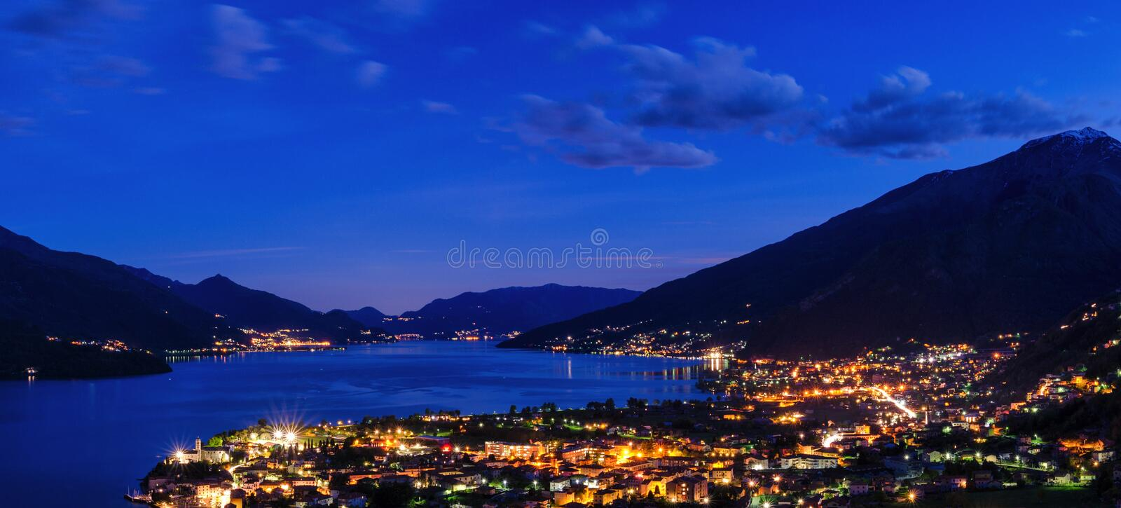 Lago di Como scenic night view with city of Gravedona. In the foreground stock photos