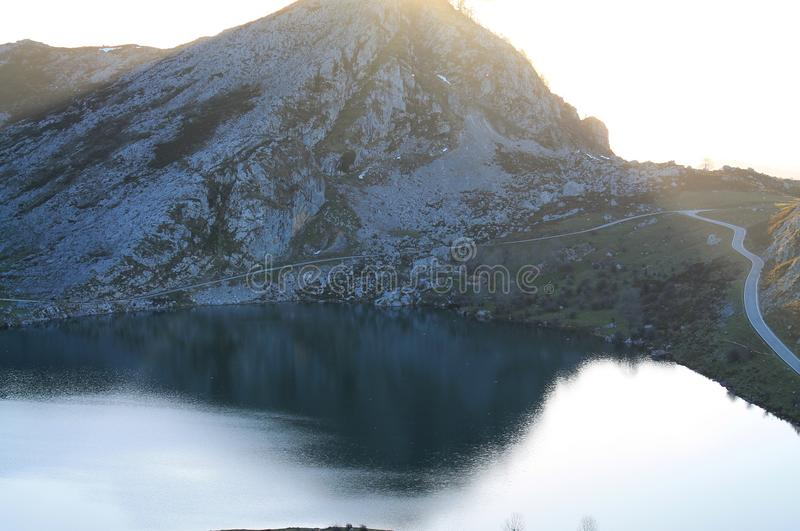 Lago Enol, Cangas de Onís, Spain. Lake Enol with the Porra de Enol mountain in the background, at sunset. Lake Enol is a small highland lake in the stock image