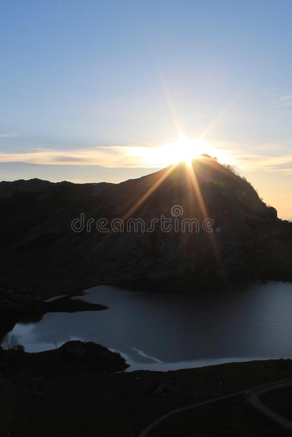 Lago Enol, Cangas de Onís, Spain. Lake Enol with the Porra de Enol mountain in the background, at sunset. Lake Enol is a small highland lake in the stock photography