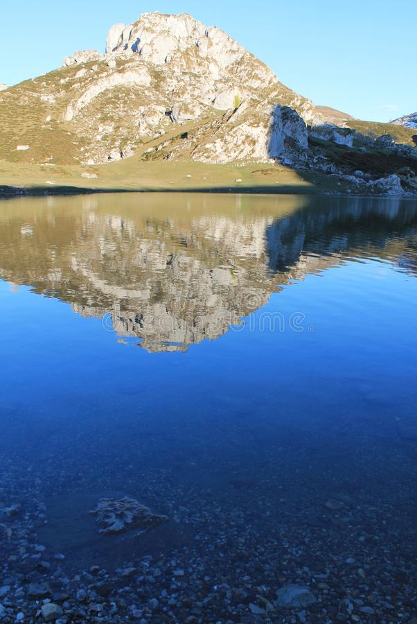 Lago Ercina, Cangas de Onís, Spain. Pico Llucia reflecting in the lake Ercina. Lake Ercina is a small highland lake in Asturias, Spain. It is a lake of stock photo