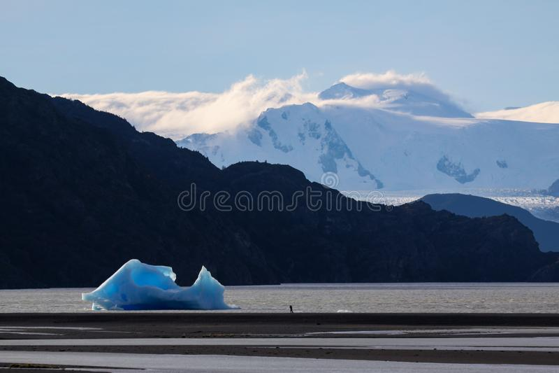 Lago Grey. Size difference shows little photographer in front of big iceberg royalty free stock images