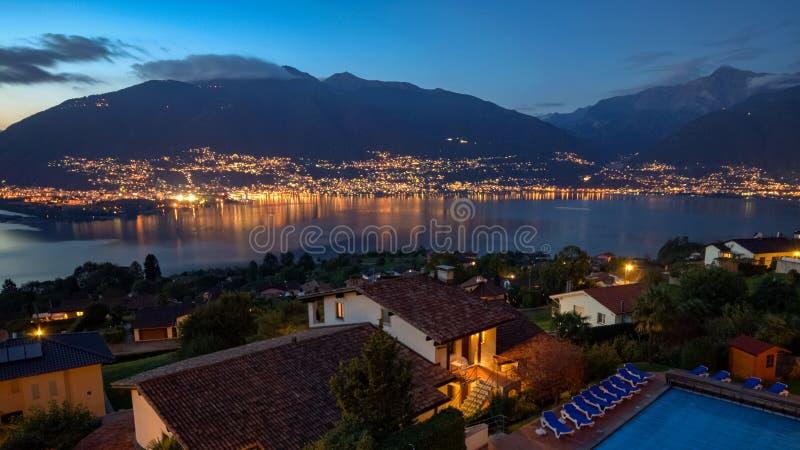 Lago Maggiore by night near Locarno Ticino, Switzerland royalty free stock images