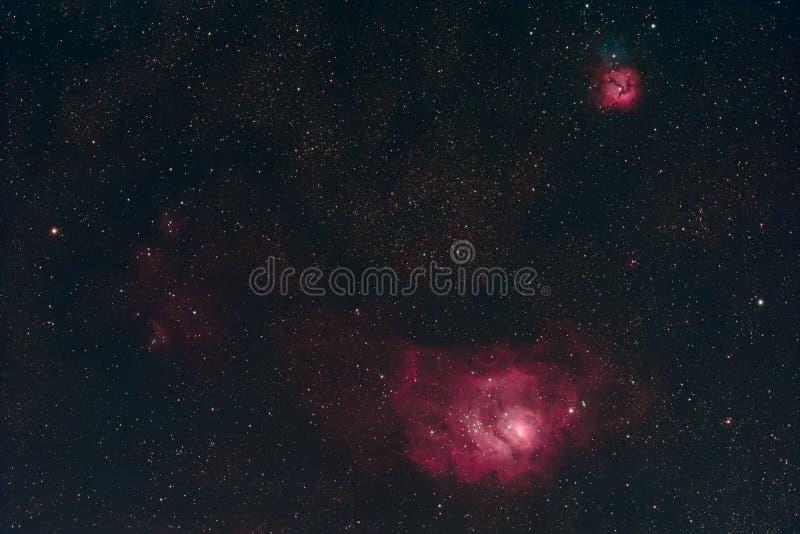 Lagoa e nebulosa Trifid foto de stock