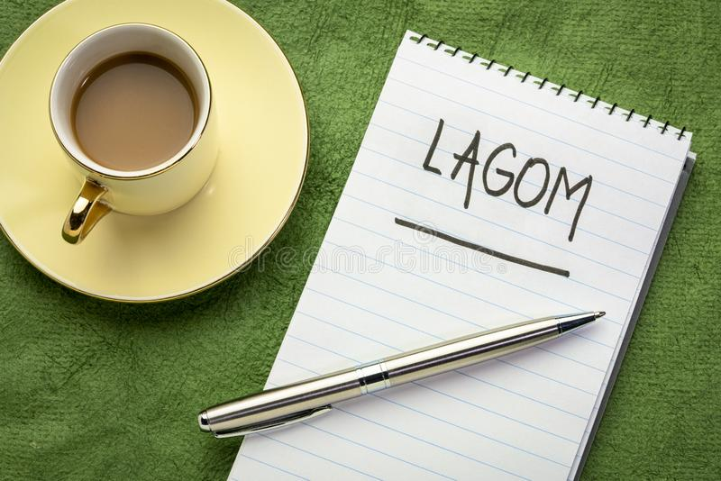 Lagom - Swedish philosophy for a balanced life. Lagom, not too little, not too much, just right - Swedish philosophy for a balanced life - black marker stock photo