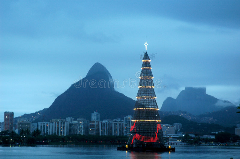 Lagoon. Lagoa Christmas Tree, a floating megastructure standing 82 meters tall over the Rodrigo de Freitas Lagoon in Rio de Janeiro, Brazil. Is onsidered the royalty free stock photography