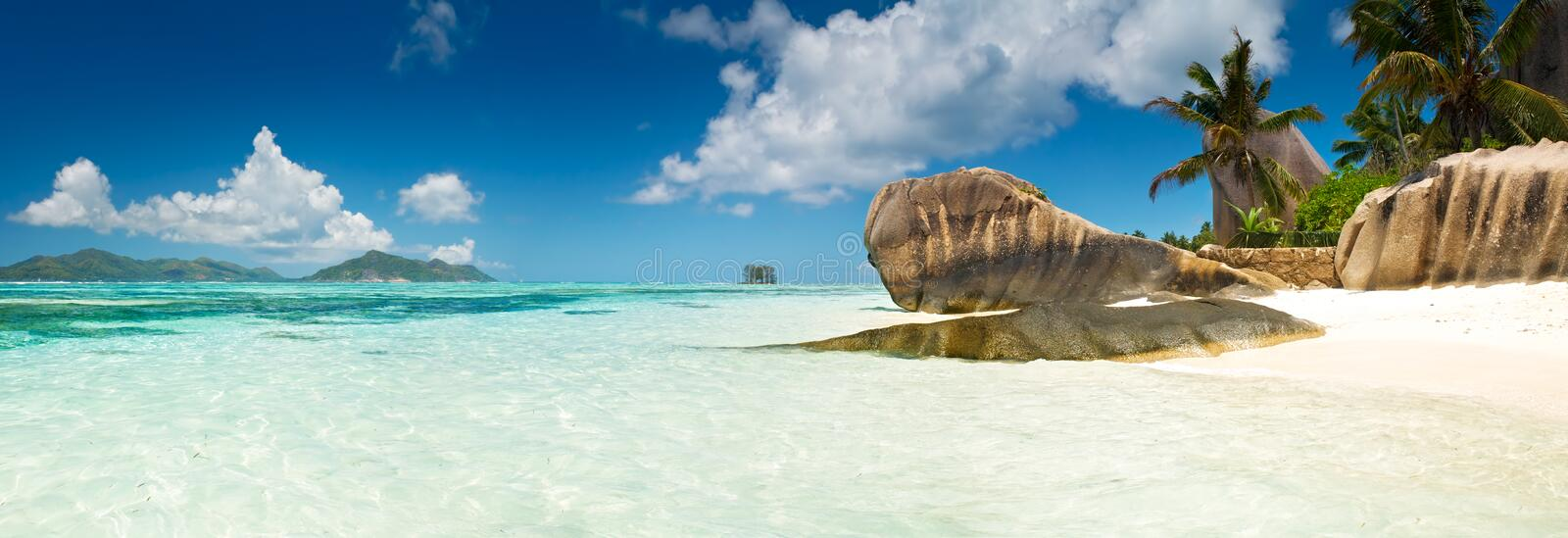 Lagoon with clean sand with stones and with a clear turquoise sea horizontal background royalty free stock photo