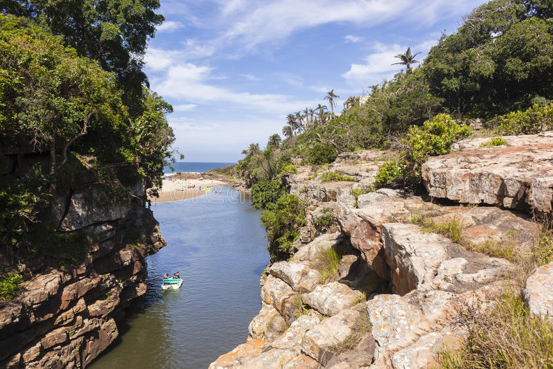 Lagoon Cliffs Paddle Boat royalty free stock photography