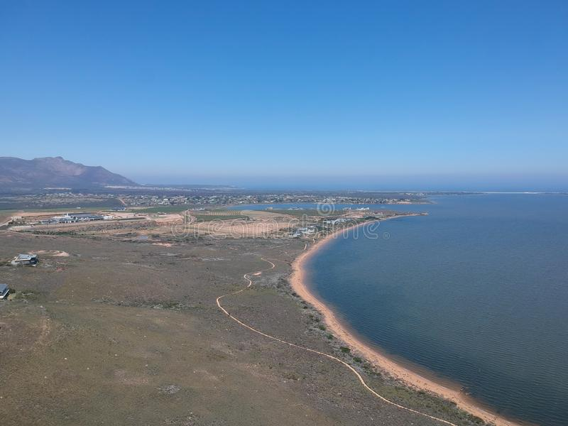 Lagoon with distant sea views. Land next to a lagoon in south africa. Blue skies and beach fronts. Sunny day and distant mountain views stock photography