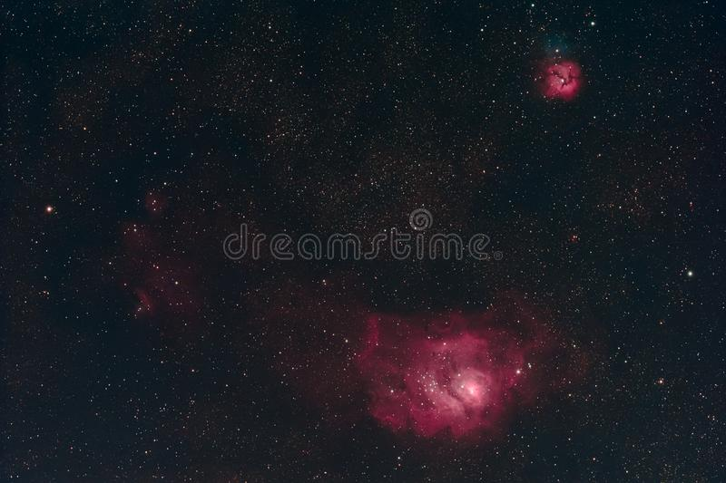 Lagoon and Trifid Nebula. The Lagoon Nebula and the Trifid Nebula in the constellation Sagittarius as seen from Mannheim in Germany royalty free illustration