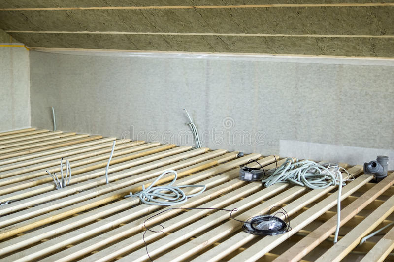 Lags and wiring before flooring. Floor boards and wiring for house construction royalty free stock photography